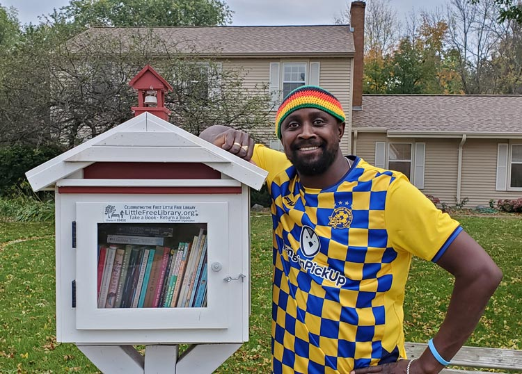 Baptiste and a Little Free Library